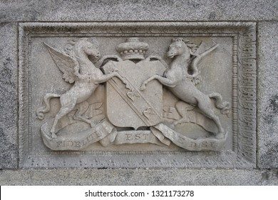 Enniskerry, Ireland - August 10th 2016: Powerscourt family crest on wall at Powerscourt house estate in Ireland with Latin inscription