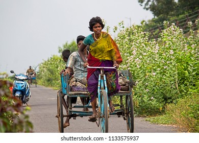 Ennore, North Chennai, Tamil Nadu, India, Sep 29, 2017: A Young Woman Cycle Rikshaw Puller On Her Livelihood