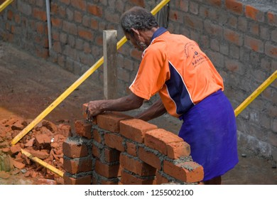 Ennore in North Chennai, Tamil Nadu in India on December 05, 2018:  Construction Worker or Construction Labor Working at a Building Construction Site
