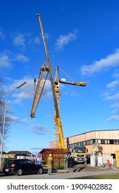 enns, austria, 04 feb 2021, mounting of a crane at the health center