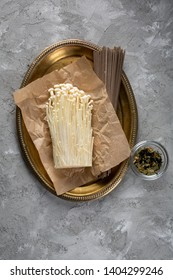 Enoki mushrooms and noodles on old plate