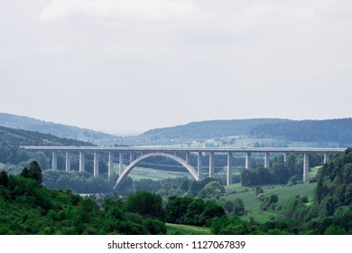 An enormous beautiful bridge across the river and the valley in Rauenstein near Coburg, Germany