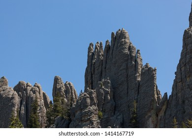 Enormous rock formations against a brilliant blue sky in the Cathedral Spires section of Custer State Park, South Dakota.