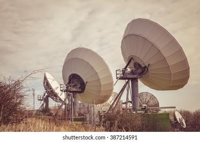 enormous sattelite transmitter in the countryside