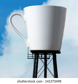 An enormous supply of coffee in the form of a coffee mug atop water tower stilts.  A funny concept for caffeine addiction or coffee / tea lovers.