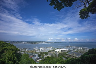 Enoshima, Japan - August 8, 2014 Panorama of Sagami Bay. On the front, Enoshima island port and on the background,  Fujisawa city, home of some of the closest sandy beaches to Tokyo and Kamakura.