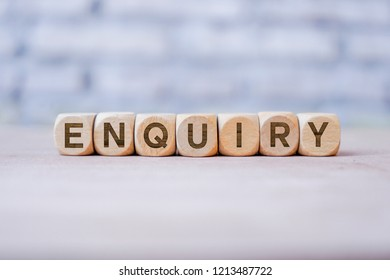 Enquiry word written on wood block