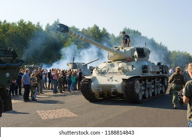 ENSCHEDE, THE NETHERLANDS - 01 SEPT, 2018: A tank from the second world war rolling during a military army show.