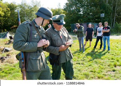 ENSCHEDE, THE NETHERLANDS - 01 SEPT, 2018: German soldiers studying a map during a military army show.