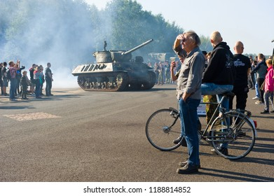 ENSCHEDE, THE NETHERLANDS - 01 SEPT, 2018: People watching tanks rolling by from the second world war during a military army show.