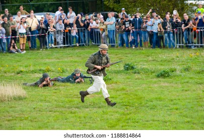 ENSCHEDE, THE NETHERLANDS - 01 SEPT, 2018: Soldiers fighting and shooting during a military army show for public.