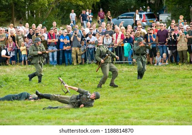 ENSCHEDE, THE NETHERLANDS - 01 SEPT, 2018: German soldiers fighting and shooting during a military army show for public.