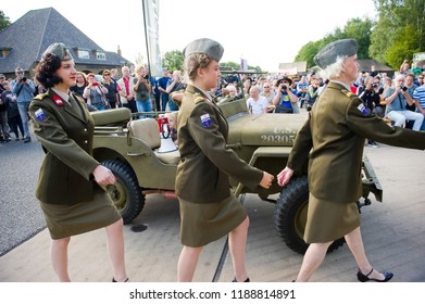 ENSCHEDE, THE NETHERLANDS - 01 SEPT, 2018: The three singers from 'Sgt. Wilson's army show' marching to the stage during a military army show.