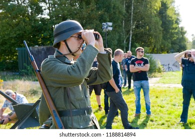 ENSCHEDE, THE NETHERLANDS - 01 SEPT, 2018: German soldier watching through binoculars during a military army show.