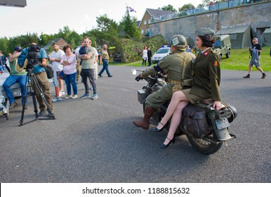 ENSCHEDE, THE NETHERLANDS - 01 SEPT, 2018: A motorcycle with on the back a singer from 'Sgt. Wilson's army show' during a military army show.