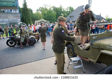 ENSCHEDE, THE NETHERLANDS - 01 SEPT, 2018: A singer from 'Sgt. Wilson's army show' stepping out of a jeep during a military army show.