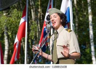 ENSCHEDE, THE NETHERLANDS - 01 SEPT, 2018: A singer from 'Sgt. Wilson's army show 'doing their stage act with historic forties songs during a military army show.