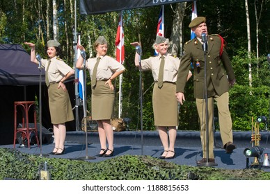 ENSCHEDE, THE NETHERLANDS - 01 SEPT, 2018: 'Sgt. Wilson's army show 'doing their stage act with historic forties songs during a military army show.