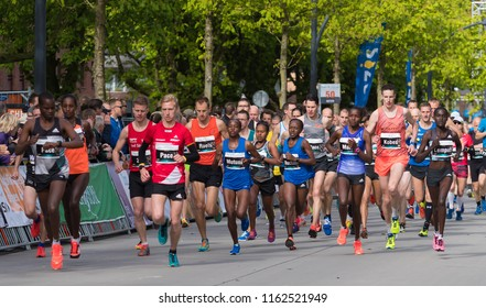 ENSCHEDE, NETHERLANDS, APRIL 23, 2017: Athletes running the Enschede Marathon under cold condistions. It is known as the oldest marathon of Western Europe.