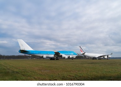 ENSCHEDE, NETHERLANDS - FEBRUARY 3, 2018: Two commercial passenger airplanes to be dismantled on a former military airfield