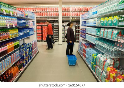 ENSCHEDE, THE NETHERLANDS - JUNE 27: People are looking, walking and shopping in the Albert Heijn supermarket between al the products in a gangway , June 27, 2013 in the Netherlands.