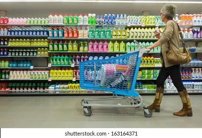 ENSCHEDE, THE NETHERLANDS - JUNE 27: A woman is looking to al the products and shopping in the Albert Heijn supermarket while pushing a shopping trolley, June 27, 2013 in the Netherlands.