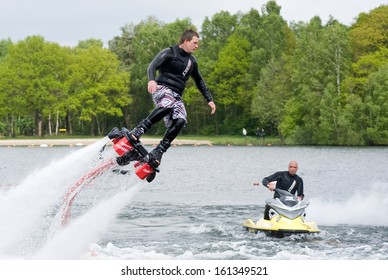 ENSCHEDE, NETHERLANDS - MAY 12: A man is giving a show how to keep in balance, and shows what you can do with the new sensation called flyboarding, May 12, 2013 in the Netherlands.