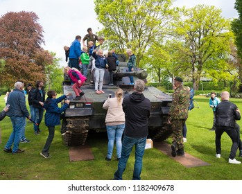 ENSCHEDE, NETHERLANDS - MAY 13, 2017: Unknown people admiring a tank during the annual dutch military open days