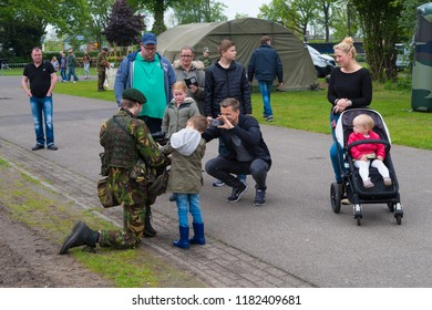 ENSCHEDE, NETHERLANDS - MAY 13, 2017: Unknown soldier posing for the cameras during the annual dutch military open days
