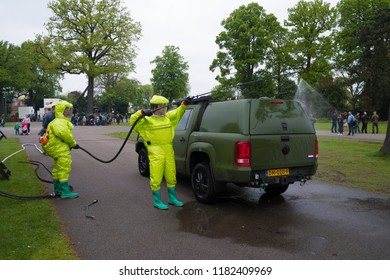 ENSCHEDE, NETHERLANDS - MAY 13, 2017: Unknown soldiers disinfecting a militrary vehicle during the annual dutch military open days