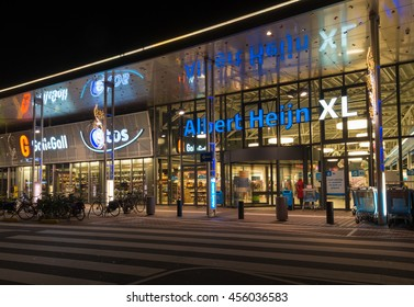 ENSCHEDE, NETHERLANDS - NOVEMBER 12, 2015: Night shot of an Albert Heijn supermarket. In the netherlands it is the largest supermarket chain with almost 1,000 shops