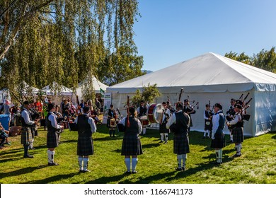 Ensemble of musicians on bagpipes. The harvest festival in Wanaka, New Zealand. The concept of rural and ecotourism