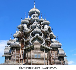 The ensemble of wooden architecture in Kizhi island. The domes Church Transfiguration  on blue sky background. Wooden architecture Russia. Kizhi Pogost on Kizhi Island, Onega Lake, Karelia. Russia