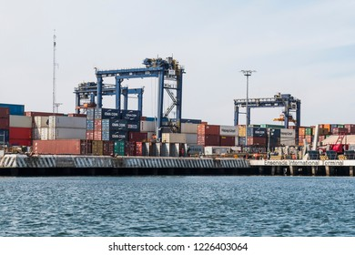 ENSENADA, MEXICO - OCTOBER 22, 2018:  Shipping containers line the docks at Ensenada International Terminal, the second busiest port in the country of Mexico.