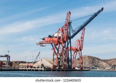 ENSENADA, MEXICO - OCTOBER 22, 2018:  Side view of the Panamax shipping cranes at the Ensenada International Terminal in the Port of Ensenada.