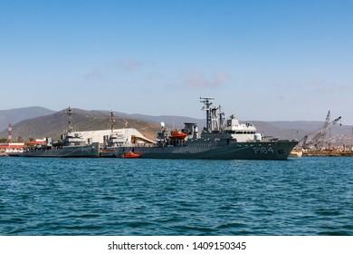 ENSENADA, MEXICO - OCTOBER 22, 2018: The Mexican Navy Oaxaca class offshore patrol vessel ARM Revolucion (P-164) and Valle class ocean patrol vessel Valentín Gómez Farías (P-110) in Ensenada Harbor.
