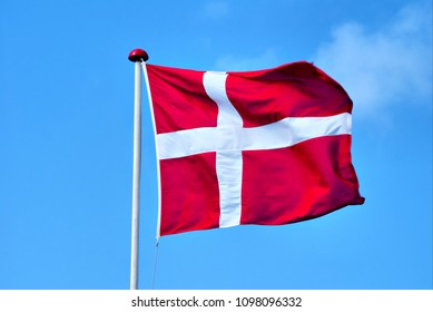 The ensign flag of the kingdom of Denmark