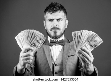 Ensuring his financial future. Bearded man hold cash money. Currency broker with bundle of money. Making money with his own business. Business startup loan. Rich businessman with us dollars banknotes.