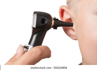ENT medical examination with the otoscope, in one child
