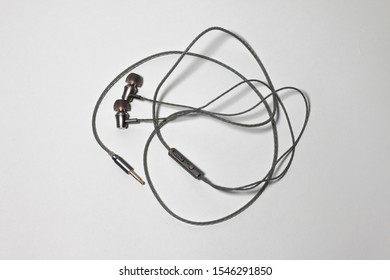 Entangled Gray Telephone Earphones isolated on White Background