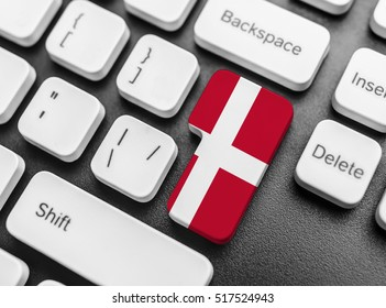 Enter key button with Flag of Denmark. Close-up.