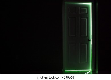 enter wonderland - dark door with green glow