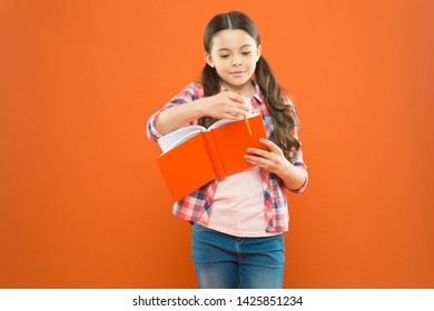 Entering a different world. Literature education. Little girl with book of english literature. Small child reading childrens literature on orange background. Literature lesson at school.