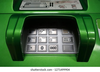 Entering personal identification number on ATM