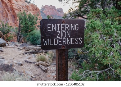 Entering Zion Wilderness trail sign at the Left Fork Trailhead in Zion National Park in Utah