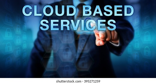 Enterprise manager is touching CLOUD BASED SERVICES on a virtual screen. Information technology concept and business strategy metaphor for integrating IT resources with applications in the cloud.