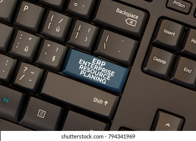 Enterprise resource planing (ERP) concept on blue button on keyboard