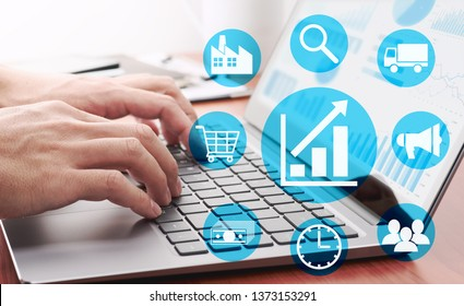 Enterprise resource planning concept. Businessman analyzing data.