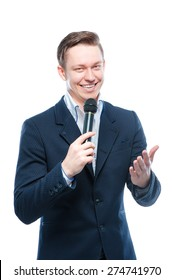 The entertainer. Young elegant talking man holding microphone, Isolated on white.