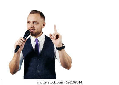 The entertainer. Young elegant talking man holding microphone, Isolated on white background